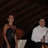 Pianista  Masha Korf şi violonistul  Cătălin Desagă, soliştii  concertului Orchestrei de Cameră Radio